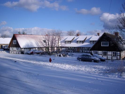 på vintern - Det högra huset av en U-längad Skånegård