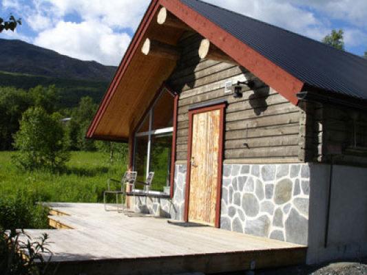 asset.ADDITIONAL_HOUSES - Byggnad med bastu, dusch och toalett ca 40 meter från stugan