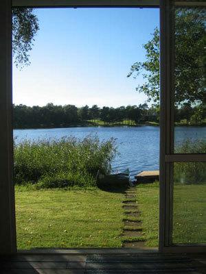 Övrig - utsikt mot sjön från inglasade uterummet