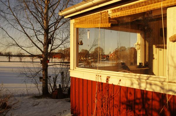 Terrass - Den inglasade verandan i solnedgång