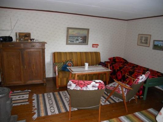 Interiör - Vardagsrummet med två sängplatser!