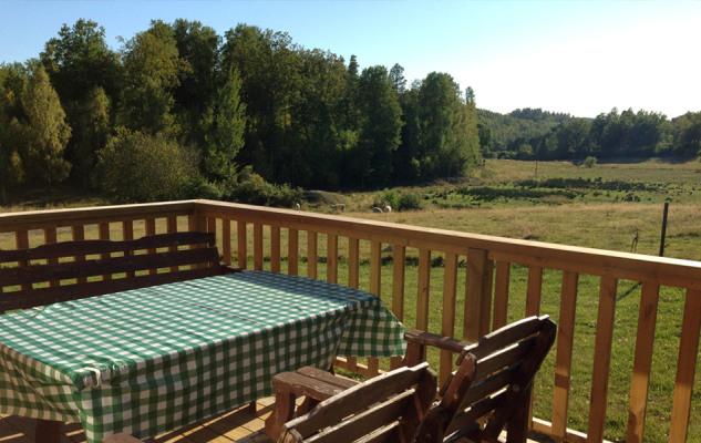 View summer - Views of the woods and pastures from the porch where you can eat breakfast, barbecue in the evening or just relax watching the views.
