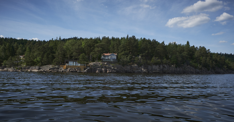 View summer - View of the cabin from the Mjörn lake