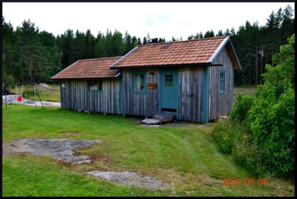 asset.ADDITIONAL_HOUSES - Bastu och garagehus. Intill liggande gungställning för de minsta.