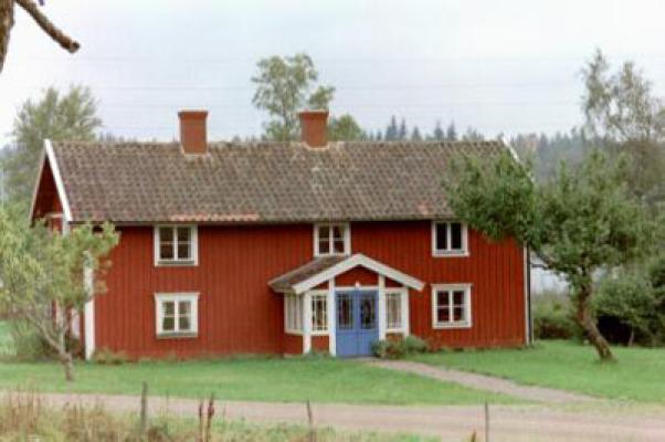 Utomhus - huset med vägen i förgrunden