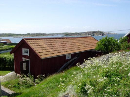 På sommaren - Huset med havet i bakgrunden