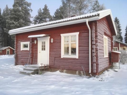 På vintern - Timrad bagarstuga från 1870.