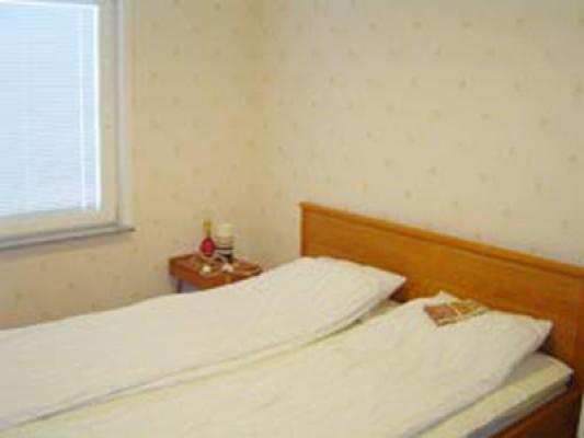 Schlafzimmer - Schlafzimmer mit Doppelbett