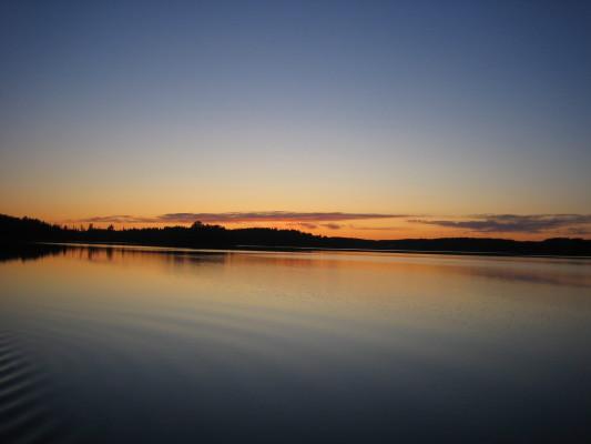 på sommaren - Solnedgång över Skundern.