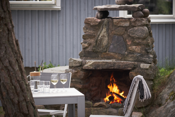 out of house - Fireplace and dinner area in the garden