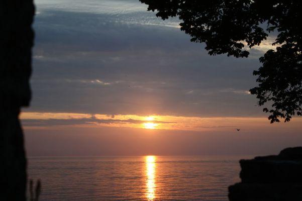 på sommaren - Solnedgång över havet.